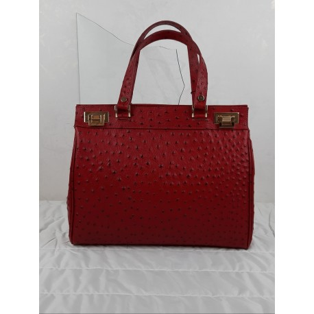 Handbag in dotted effect leather